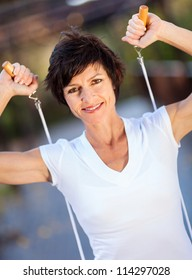 active middle aged woman with jumping rope