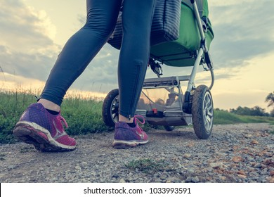 Active mother running with baby stroller.