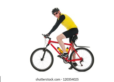 Active mountainbiker rides in studio isolated over white background