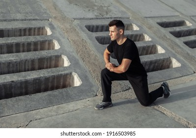 Active muscular man exercising outdoors on concrete slabs. Healthy lifestyle concept