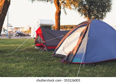 Active outdoor recreation in a tent. Two tents outdoors in the evening sun rays