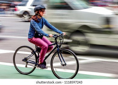 active people on bicycle  in the city roadway  in motion blur