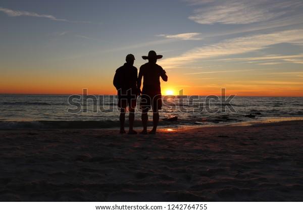 Active retired senior enjoying the beach and the sunset on Siesta Key beach, Sarasota Florida