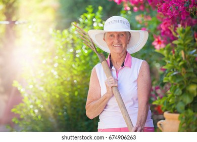 active retirement, senior woman gardening with sun flare