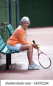Active senior on the tennis court.