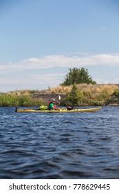 An active senior paddles a sea kayak on Georgian Bay, in Ontario, Canada.