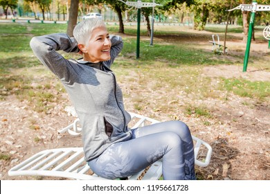 Active Senior Woman Exercise At Outdoor Gym, Healthy Lifestyle