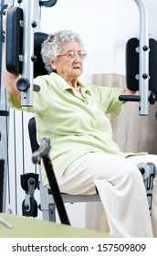 Active  senior woman in a gym