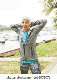 Active Senior Woman In Sportswear Doing Fitness Exercise, Workout Outdoor.