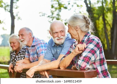 Active seniors talking as friends on a summer outing