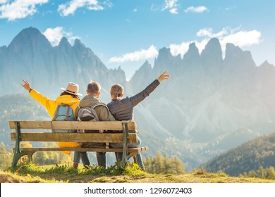 Active three friends travel during autumn holiday and vacation in the mountains of the Dolomites in the Bolzano region in Italy