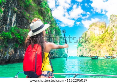 Active traveler Asian girl joy and fun on boat using action cam take photo Phi let lagoon Krabi, Travel nature Phuket Thailand, Tourism beautiful destination Asia, Tourist summer holiday vacation trip