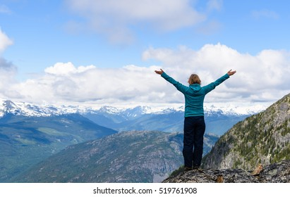 Active traveler hiking, enjoying the view, looking at mountains landscape. Mountaineering sport lifestyle concept. Canada