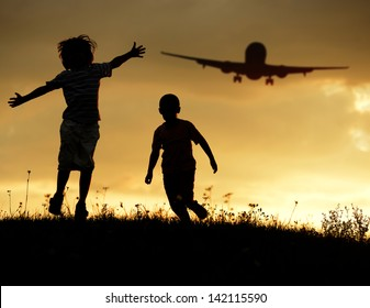 Active two kids jumping while the airplane landing in air