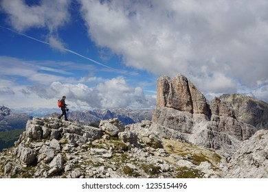 Active vacation in Dolomites / Dolomiti - Averau - Nuvolau area (Italy). Young man walking towards via ferrata route on a sunny day of summer