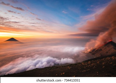 Active volcano at sunrise in Guatemala from mountain summit