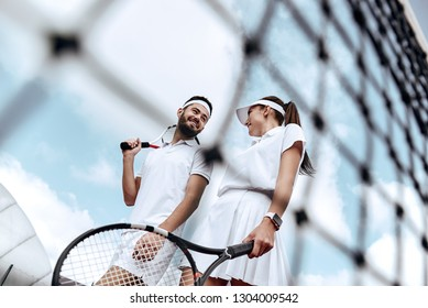 Active weekend together. Lovers play tennis