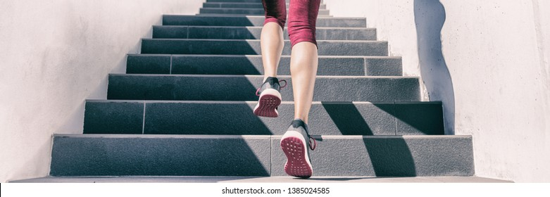 Active weight loss training workout running up stairs for hiit workout cardio training. Staircase climbing run woman going run up steps panorama banner. Runner athlete doing sport workout.