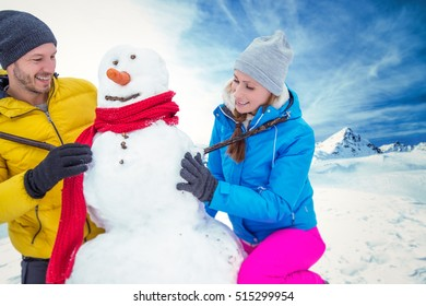 active winter couple in mountains