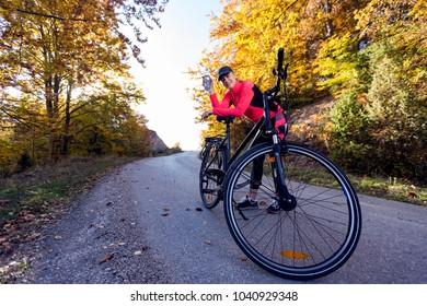 Active woman with bike at autumn day
