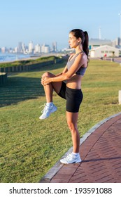 active woman doing fitness exercise beach