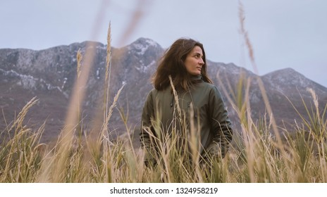 Active woman enjoying valley and autumn mountain view in Montenegro