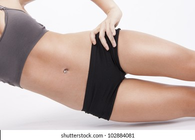 Active woman exercise her abs