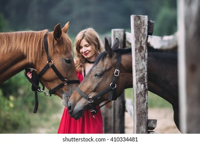 active woman feels happiness and admires horses