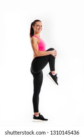 Active woman performs exercises for legs on white background. Strength and motivation