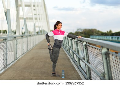 Active woman stretching legs on the bridge