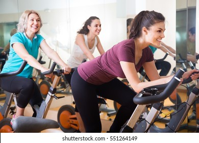 Active women of different age training on exercise bikes together