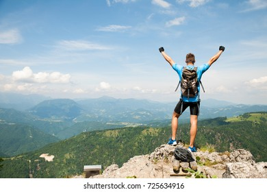 Active young amn gesture success after climbing a mountain