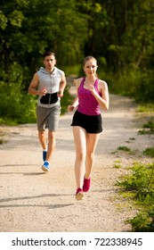Active young couple running in the park