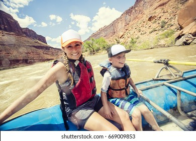 Active young family enjoying a fun whitewater rafting trip