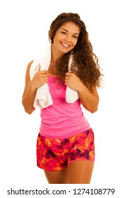 active young fit woman rests after workout with towel around her neck