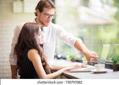 Active and Young Smart Confident Businessman Helping new Woman Worker.Business Freelanc Co-Working Space Luxurious Serviced Office For Rent Concept. Setup studio shooting.