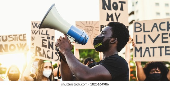 Activist movement protesting against racism and fighting for equality - Demonstrators from different cultures and race protest on street for equal rights - Black lives matter protests city concept