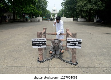 Activist of PETA in elephant and mahout attire to creates awareness urging people to refrain taking elephant rides ahead of World Tourism day on September 26, 2018 in Calcutta, India.