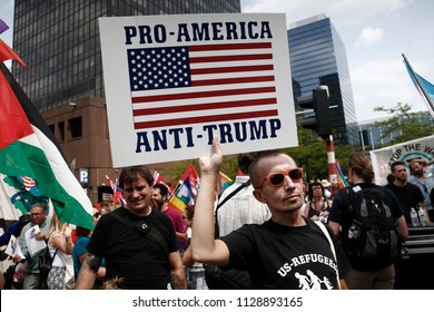 Activists protest against President Donald Trump in the context of Trump's visit to Brussels, Belgium on Jul. 7, 2018.