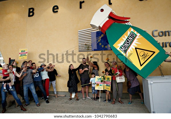 Activists take part in a protest against Biotechnology giant Monsanto, outside the European Commission headquarters in Brussels, Belgium on Jul. 19, 2017.