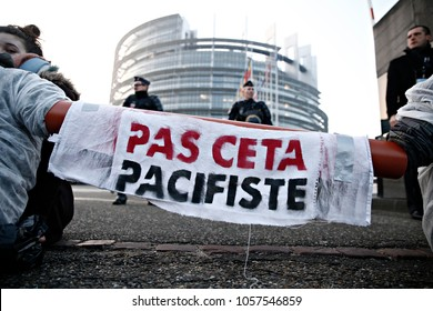 Activists try to block the entarnce of  EU Parliament during a demonstration against the Transatlantic Trade and Investment Partnership in Strasbourg, France on Feb. 15, 2017