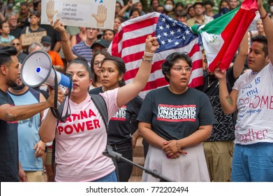 "Activists wearing a t-shirt reading ""Undocumented and Unafraid"" an ""Latina Power"" at a rally to protest president Donald Trump's decision to end DACA Downtown Portland, OR, on September 5th, 2017."