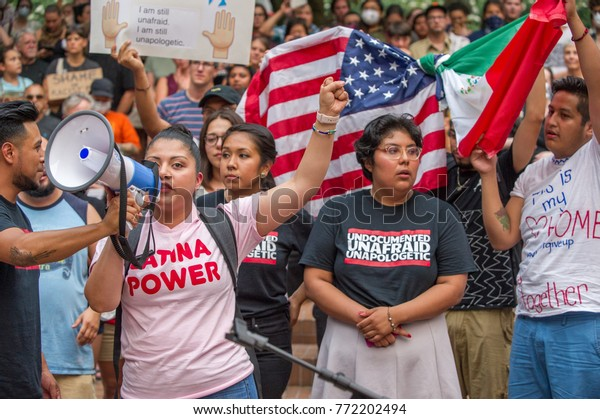 """Activists wearing a t-shirt reading """"Undocumented and Unafraid"""" an """"Latina Power"""" at a rally to protest president Donald Trump's decision to end DACA Downtown Portland, OR, on September 5th, 2017."""
