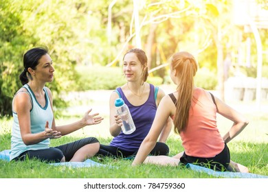 Activities in the family, mother and daughter relaxing in the park after practicing yoga.