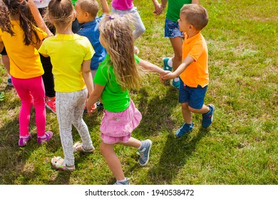 Activities for kids of different ages on green lawn