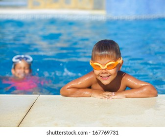 Activities on the pool. Cute boy in swimming pool