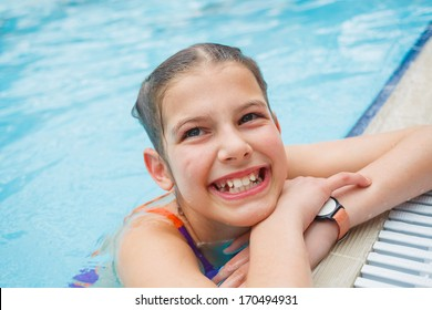 Activities on the pool. Cute girl in swimming pool