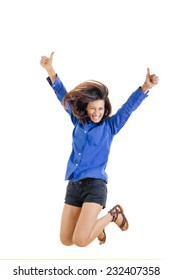 activity and happiness concept , successful smiling teenage girl or woman happy for her success in blue blank shirt and jeans shorts jumping with thumbs up