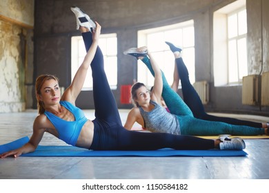 Activity, sport, endurance, good mood, healthy lifestyle. Women group workout. Sporty ladies stretching during yoga class