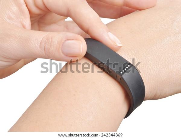 Activity tracker on a woman's wrist